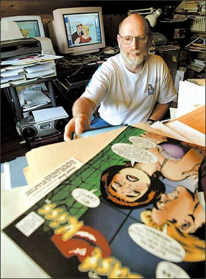 Comic-book writer John Lustig, here in his home office, has organized the 24-hour comic-book marathon that will be held in Seattle this weekend. Photo: Grant M. Haller, Seattle Post-Intelligencer / Seattle Post-Intelligencer