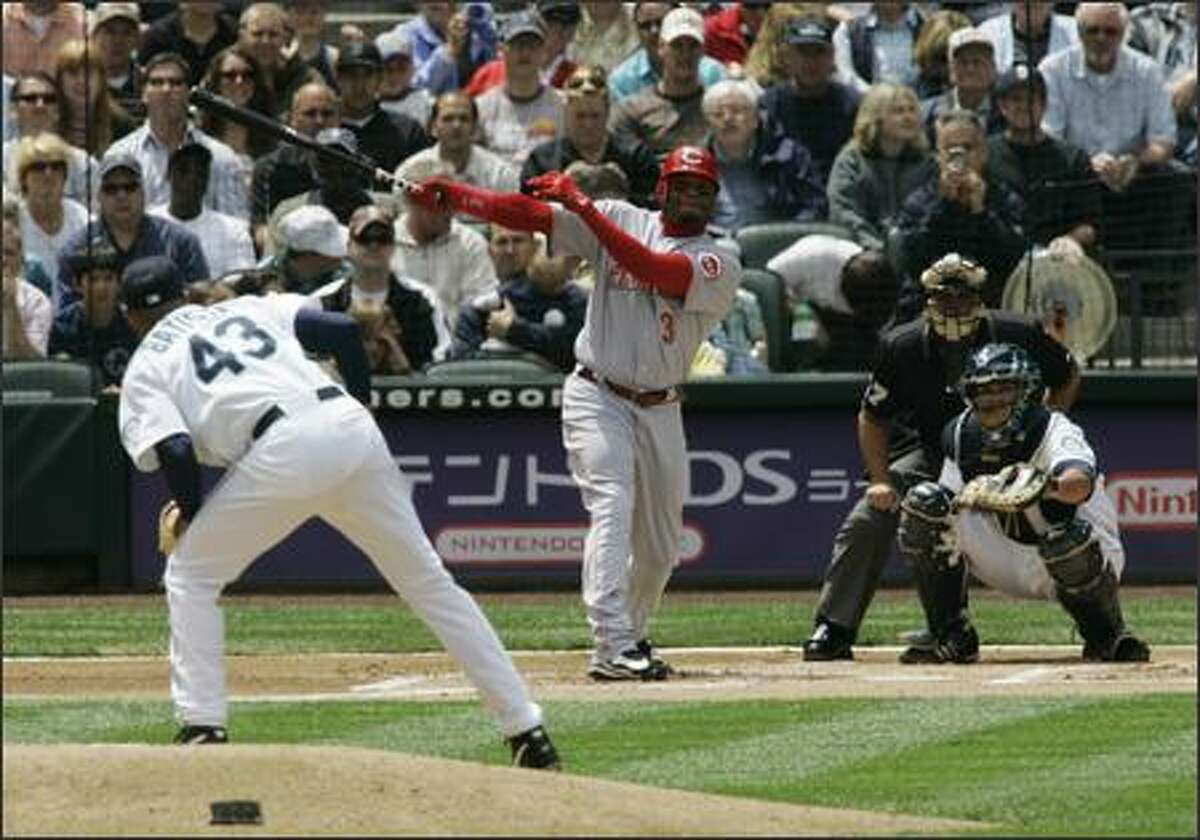 Cincinnati Reds' Ken Griffey Jr. watches his solo home run off of Seattle Mariners starter Miguel Batista (43) take flight in the first inning. (AP Photo/Ted S. Warren)