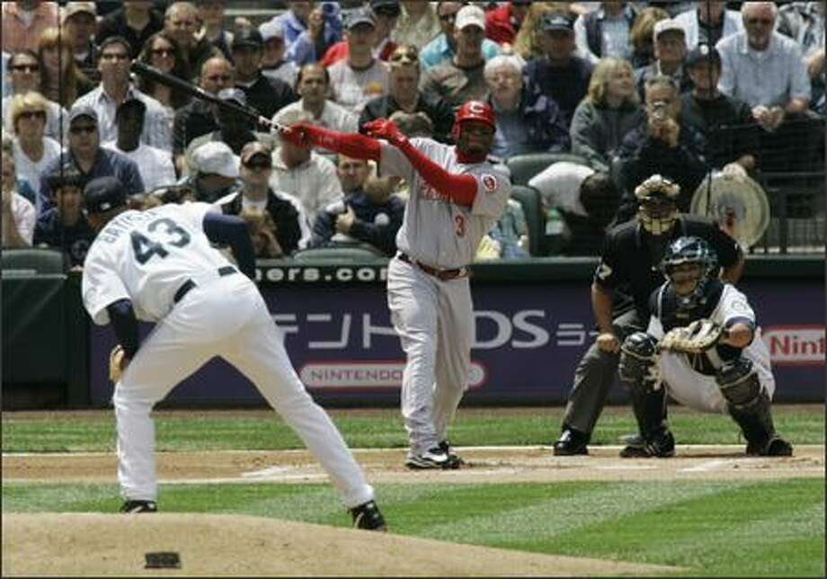 Cincinnati Reds' Ken Griffey Jr. watches his solo home run off of Seattle Mariners starter Miguel Batista (43) take flight in the first inning. (AP Photo/Ted S. Warren) Photo: Associated Press / Associated Press