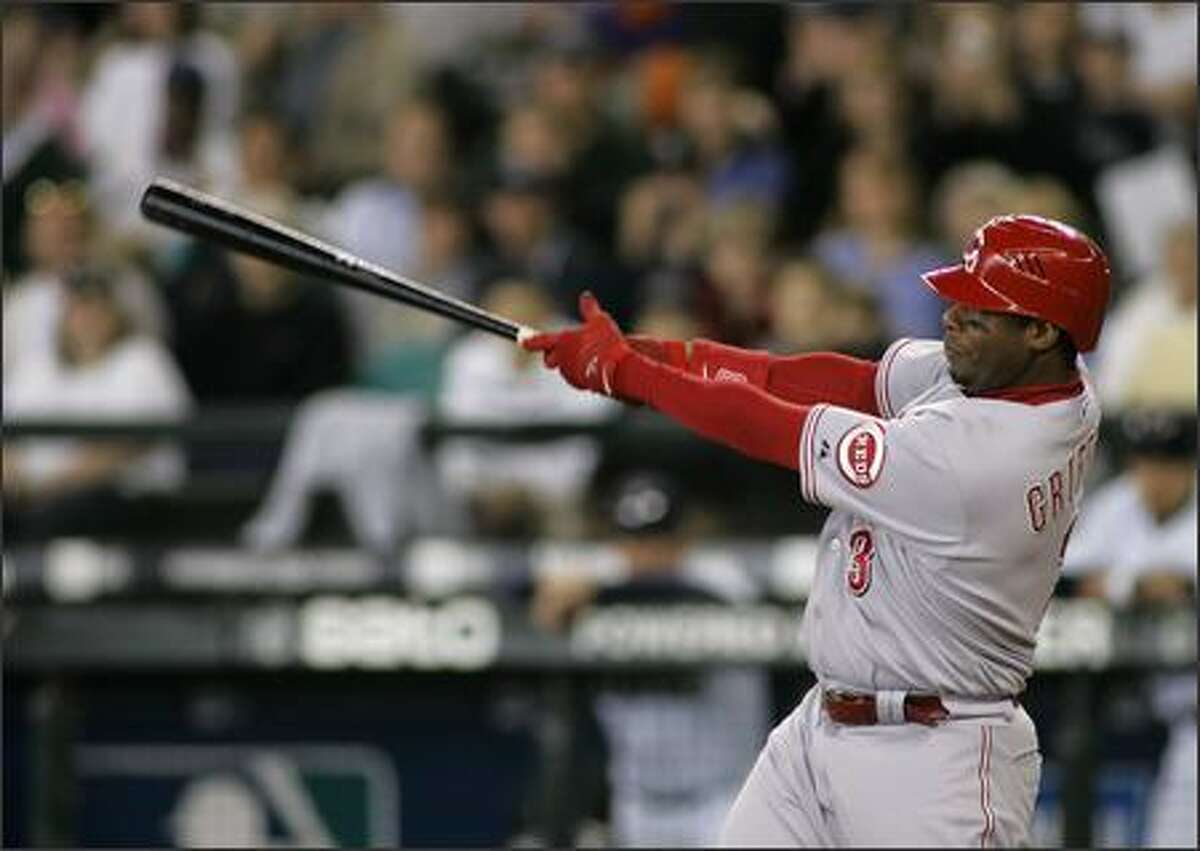 Cincinnati Reds' Ken Griffey Jr. hits a solo home run off of Seattle Mariners starter Miguel Batista in the fifth inning. The home run, Griffey's second in the game, moved Griffey past Mark McGwire to seventh place in all-time home runs at 584. (AP Photo/Ted S. Warren)
