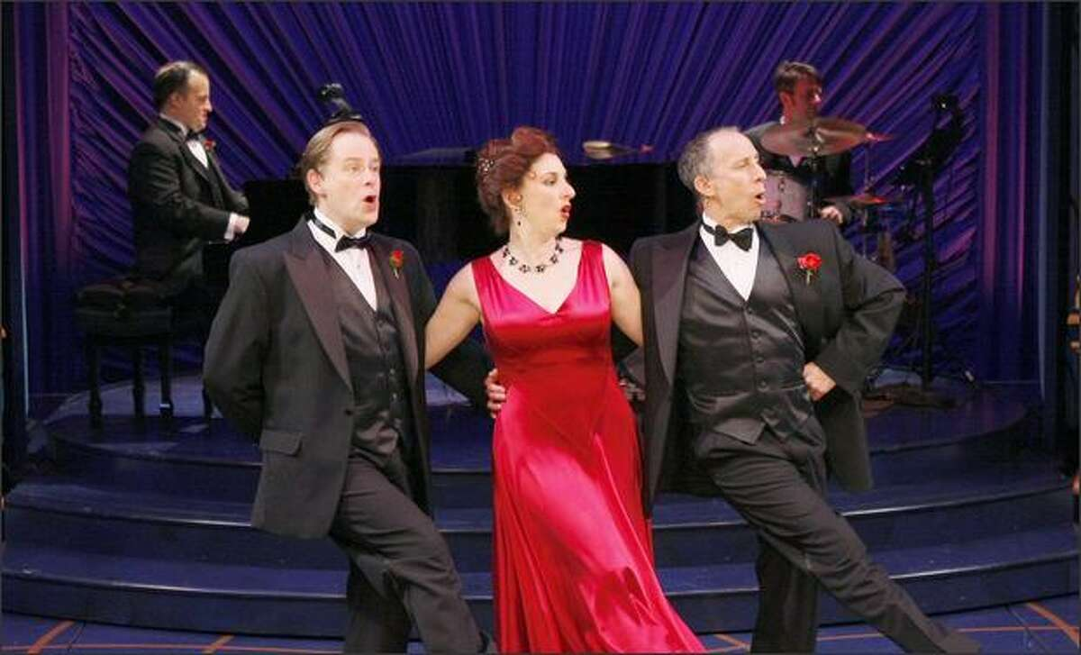 Performers Mark Anders, left, Anna Lauris and David Silverman kick up their heels in ACT Theatre's celebration of Noel Coward.