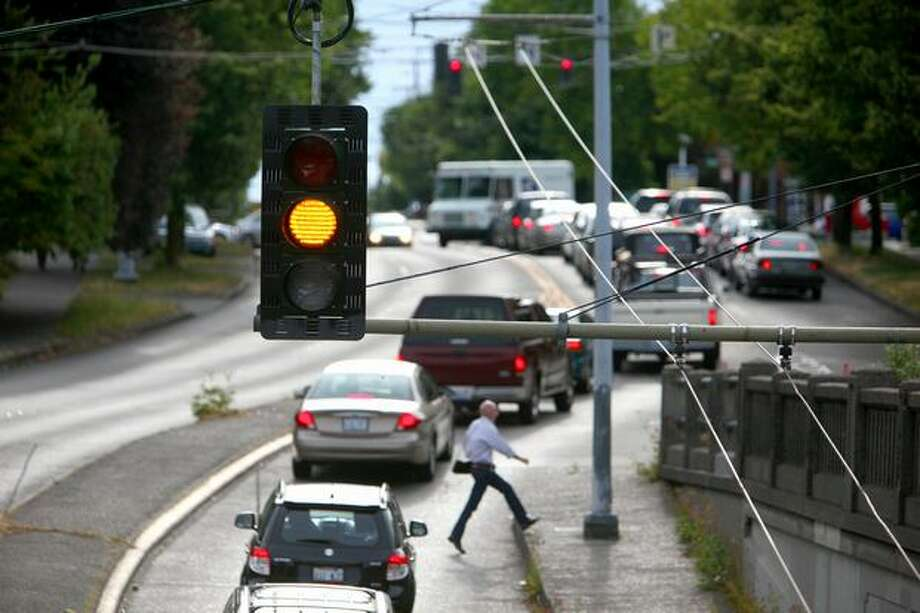 A new stoplight installed by SDOT flashes yellow on North 46th Street, under Aurora Avenue North in Seattle's Wallingford neighborhood. Photo: Joshua Trujillo, Seattlepi.com / seattlepi.com