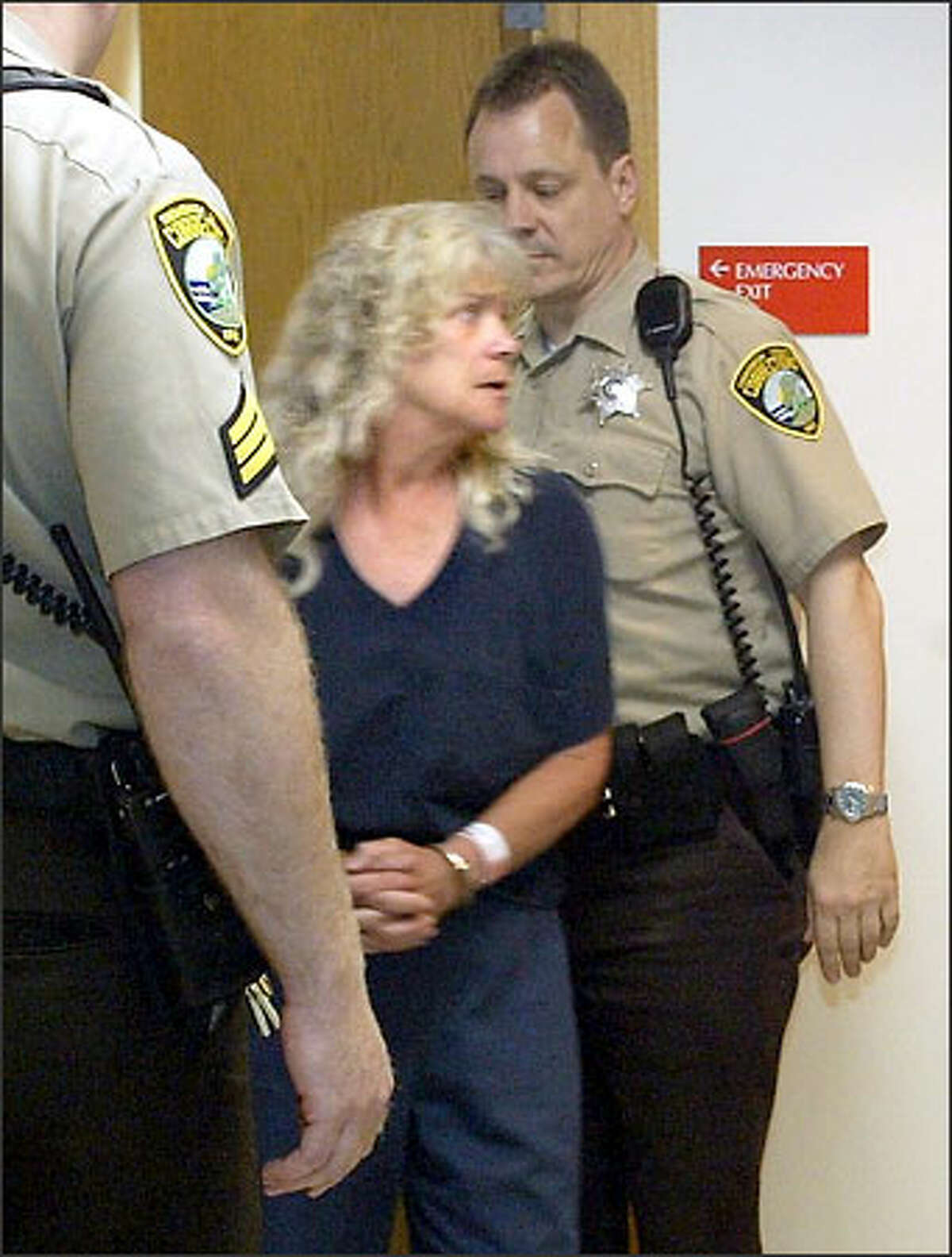 Noreen Erlandson enters Snohomish County Superior Court yesterday. She has maintained her innocence.