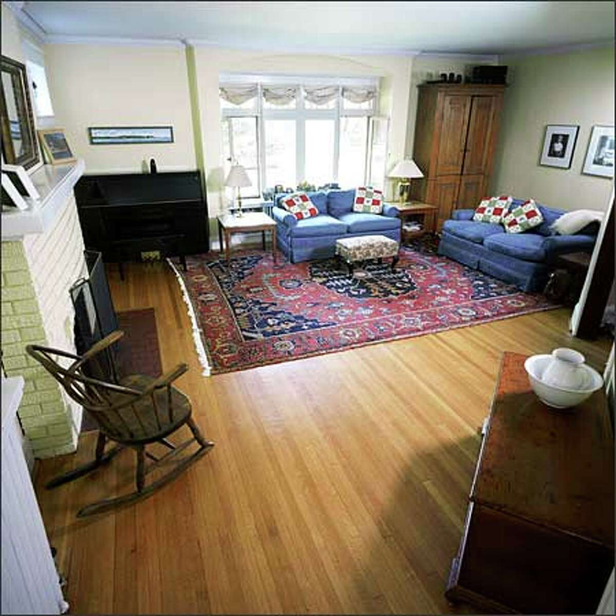 Two couches seem small in this large room. Also, the window treatment does not do justice to the main window, which boasts a wonderful arch.