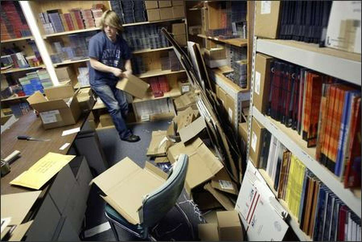 Matt Harrow, a retail intern at Light in the Attic Records, packages music to be shipped out of the company's headquarters in Seattle. Matt Sullivan started the record label in 2002 to focus on reissuing classic albums, but the company has since expanded to sign present-day bands as well.
