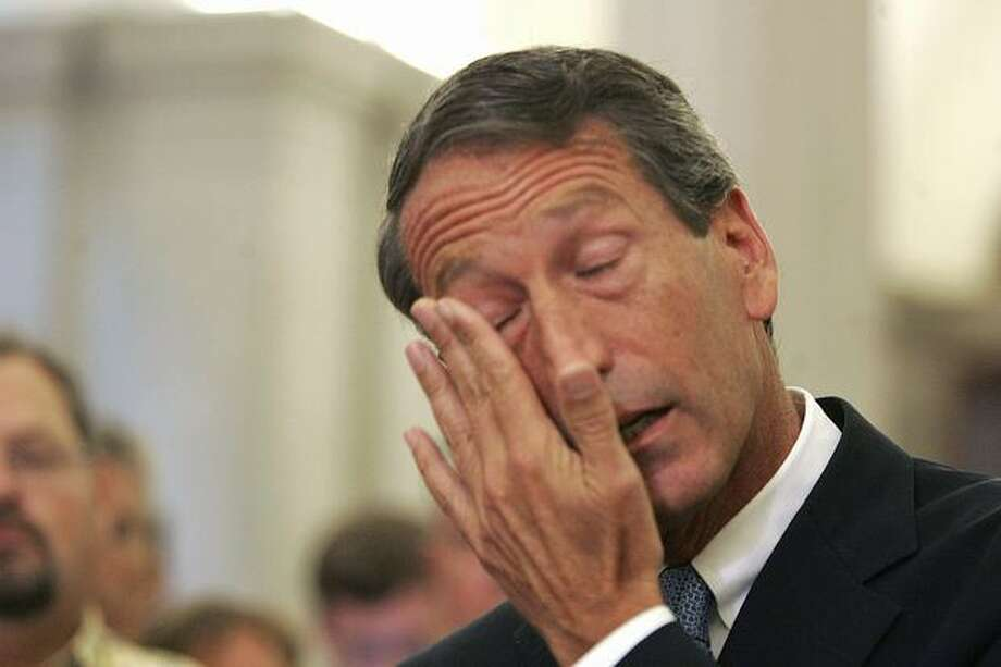 "South Carolina Gov. Mark Sanford wipes his tears as he admitted to having an affair during a news conference in Columbia, S.C Wednesday, June 24, 2009, and said he is resigning as chairman of the Republican Governors Association. ""I spent the last five days crying in Argentina,"" Sanford said. (AP Photo/Mary Ann Chastain) Photo: Associated Press / Associated Press"