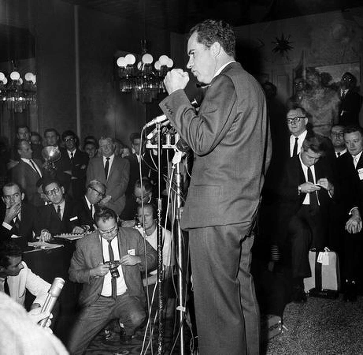 In this Nov. 7, 1962 file photo, former Vice President Richard M. Nixon shakes his fist as he makes remarks about news coverage of his campaign for governor as he conceded defeat in the race for the California governorship, in Beverly Hills. He told the large group of reporters: