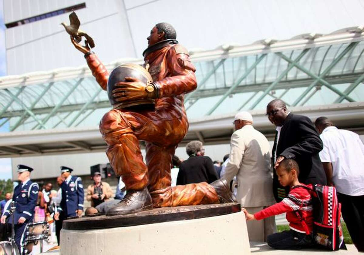 Saibrien Thomas, 6, checks out a new statue of astronaut Michael P. Anderson at Boeing's Museum of Flight after it was unveiled. Anderson, who was a native of Washington, died during the 2003 disintegration of the space shuttle Columbia over Texas. Museum CEO Bonnie Dunbar, who flew with Anderson on STS-89 in 1988, said the statue of her fellow astronaut was placed near the entrance school children use so he can be an inspiration to future scientists and adventurers.