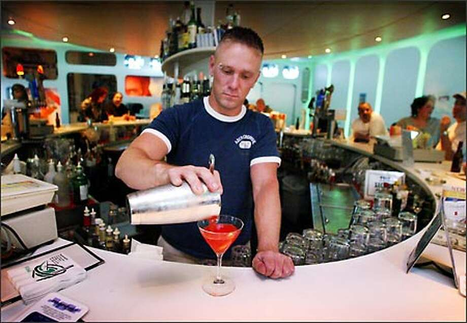Bartender Brad Sentek mixes a drink for a customer at Manray's, a gay nightclub at 514 Pine St. Photo: Gilbert W. Arias, Seattle Post-Intelligencer / Seattle Post-Intelligencer