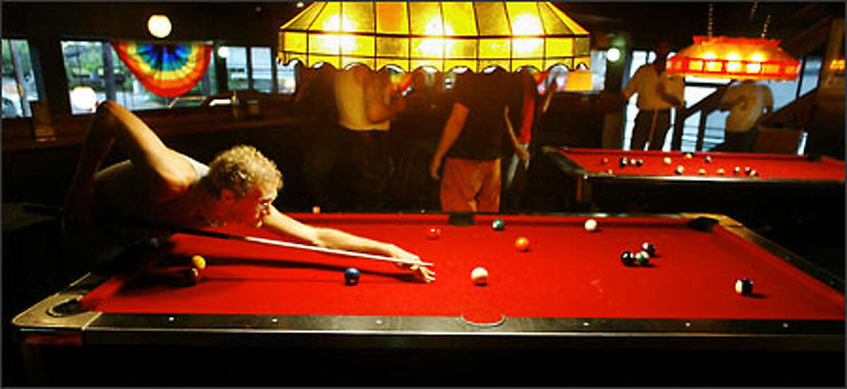 Martin Horn shoots pool with friends at R Place, a gay club on Pine Street.