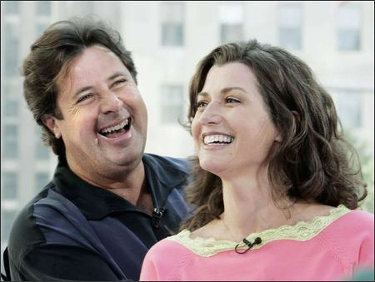 Country singer Vince Gill and his wife, five-time Grammy Award winner Amy Grant, looked like they had a good time appearing on the
