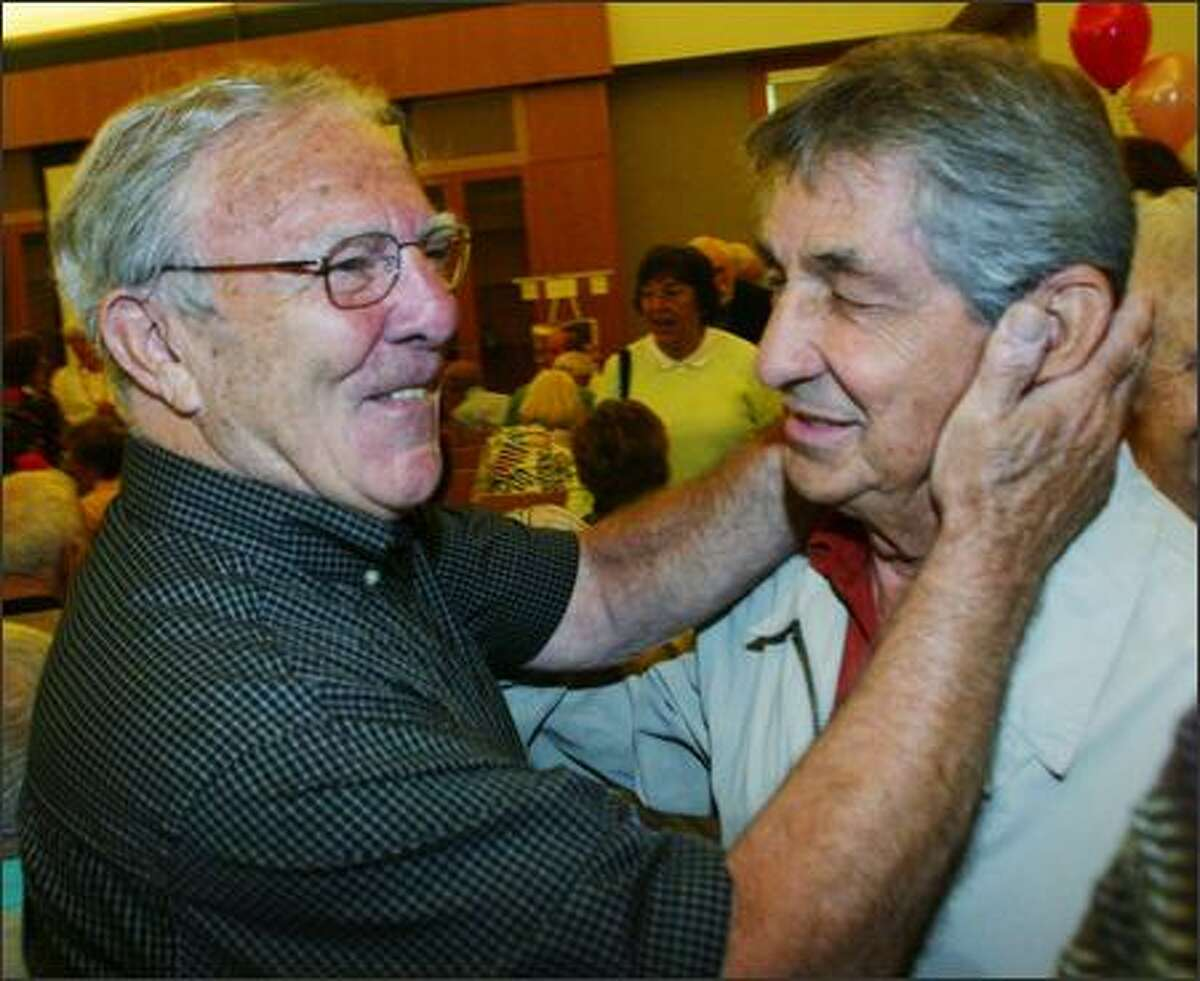 Albert Cordova, left, greets Jack Israel at the reunion of Jewish youth organizations from Seattle of the 1940s and '50s at Hillel at the University of Washington.