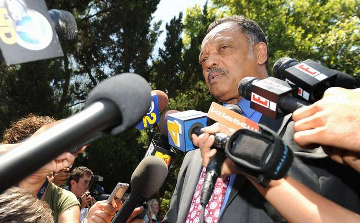 The Rev. Jesse Jackson reads a statement from the family of late music legend Michael Jackson outside the Jackson family compound in Encino, Calif., on Saturday.