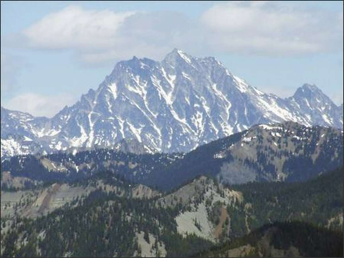 The craggy summit of 9,415-foot Mount Stuart dominates the view from the 4,800-foot level of the Domerie Peak Trail east of Snoqualmie Pass.