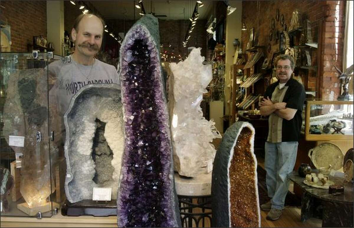 Mark Kullberg, left, and Terry Derosier are the co-owners of the Pioneer Square store Agate Designs, which specializes in crystals, minerals and fossils.
