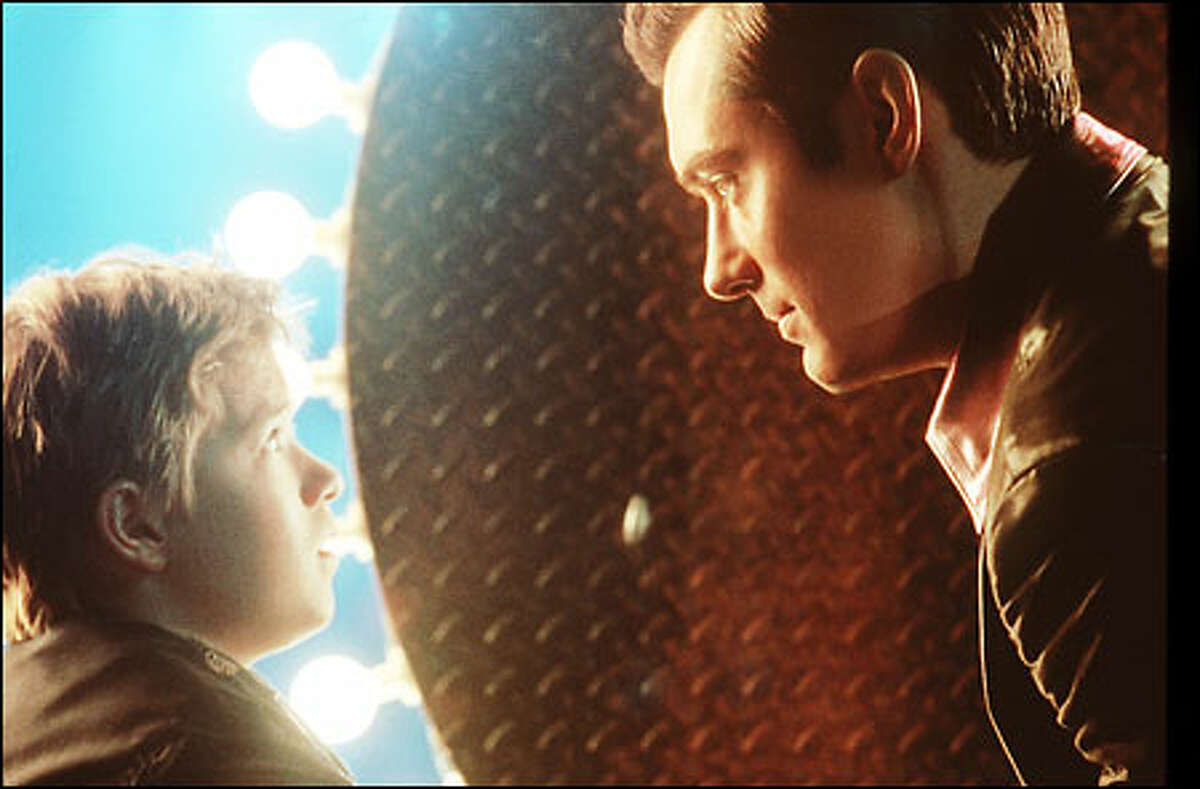 Haley Joel Osment, left, plays the first child robot capable of love, designed to ease the loneliness of a childless couple; Jude Law is Gigolo Joe, a robot who services lonely women.