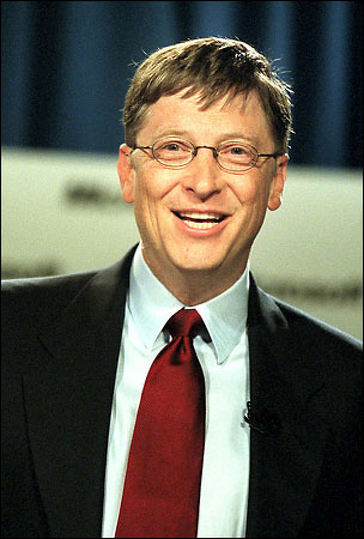 Microsoft's Bill Gates smiles as he talks about the appeals court decision handed down yesterday.