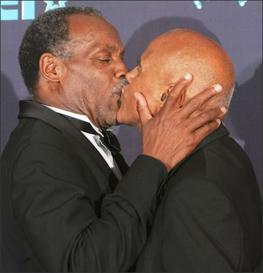 Brotherly love among stars is up close and personal. Presenter Danny Glover, left, kisses Harry Belafonte backstage after Belafonte received the Black Entertainment Television's humanitarian award during the sixth annual BET ceremony on Tuesday in Los Angeles. Photo: Associated Press / Associated Press