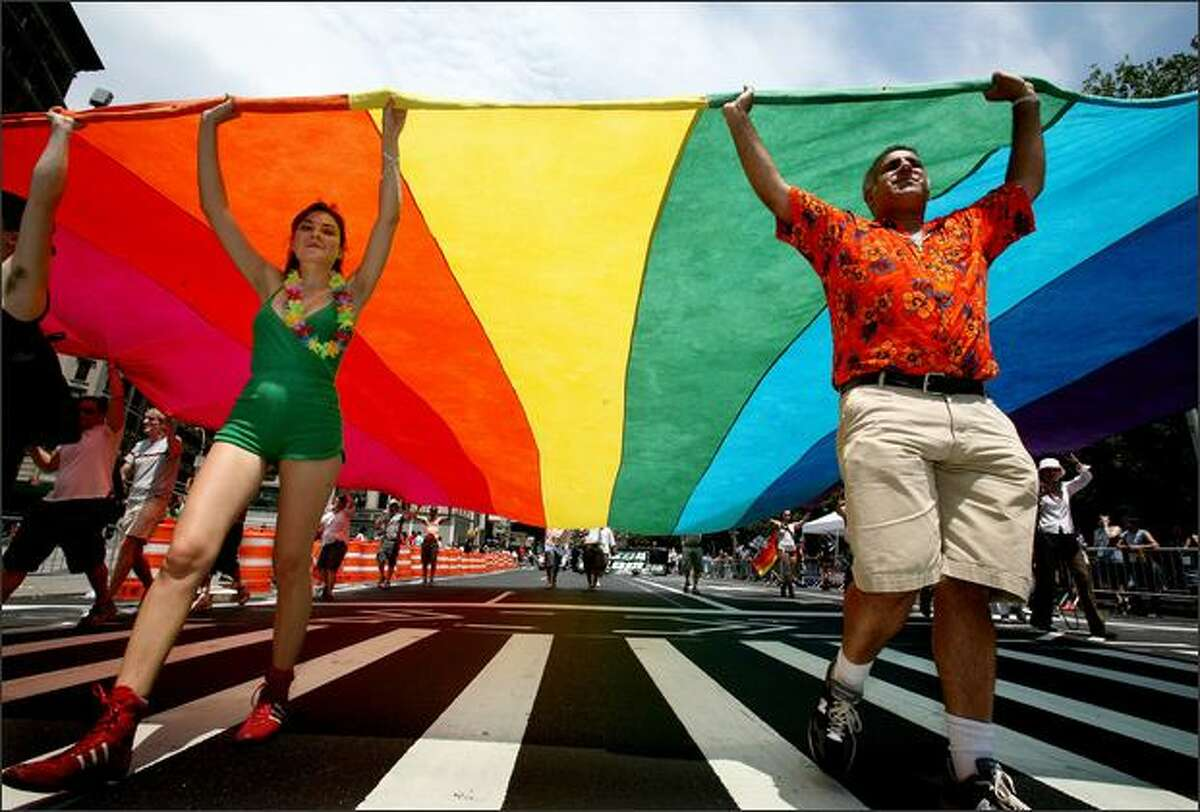 Marchers carry a rainbow flag at the gay pride parade along Fifth Avenue in New York on Sunday.