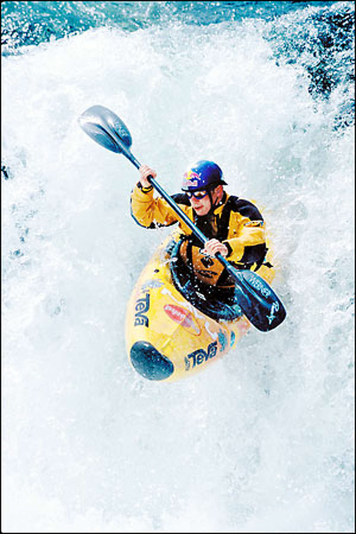 The way of Tao Berman is to conquer rivers while taking risks. He holds the world record for making the highest drop from a waterfall. Above: Berman negotiates a drop in the south fork of the Tuolumne River near Yosemite National Park last spring. Top: He paddles down one of a series of waterfalls on the Sheep River in British Columbia earlier this month.