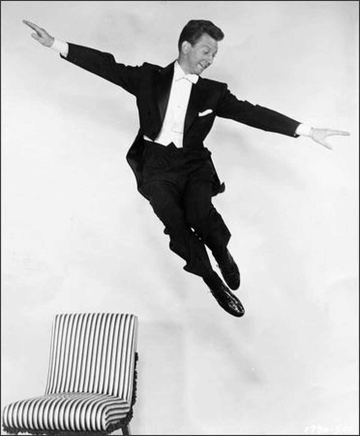"""You can buy the tap shoes he wore in """"Singin' in the Rain,"""" but you can't tuck them under yourself and defy gravity, as Donald O'Conner did in this 1954 promotional photo from Universal Studios. Three years after his death at 78, his family is selling key items from the master of smooth moves, starting Friday."""