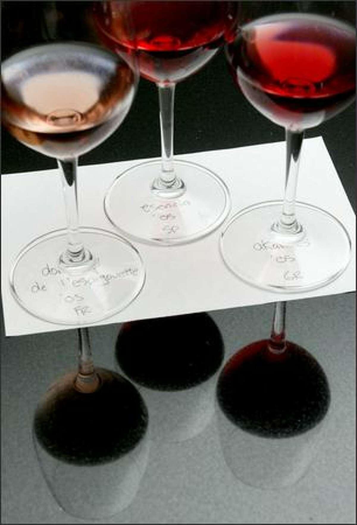 A flight of wines is set on a handwritten