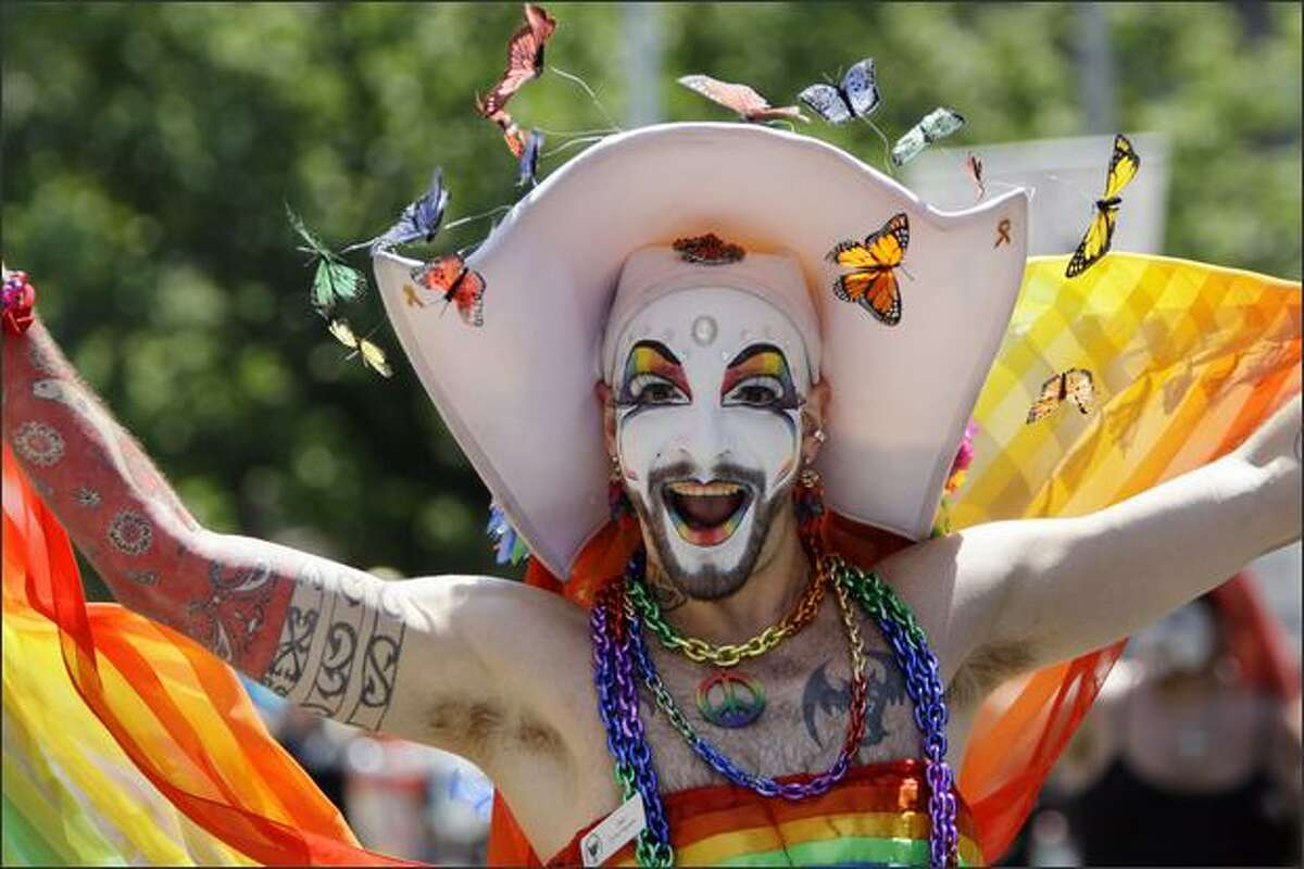A member of the Sisters of Perpetual Indulgence, known when in costume only by his stage name of Sister Erotica Psychotica, marches in Seattle at the annual Gay Pride parade on Sunday.