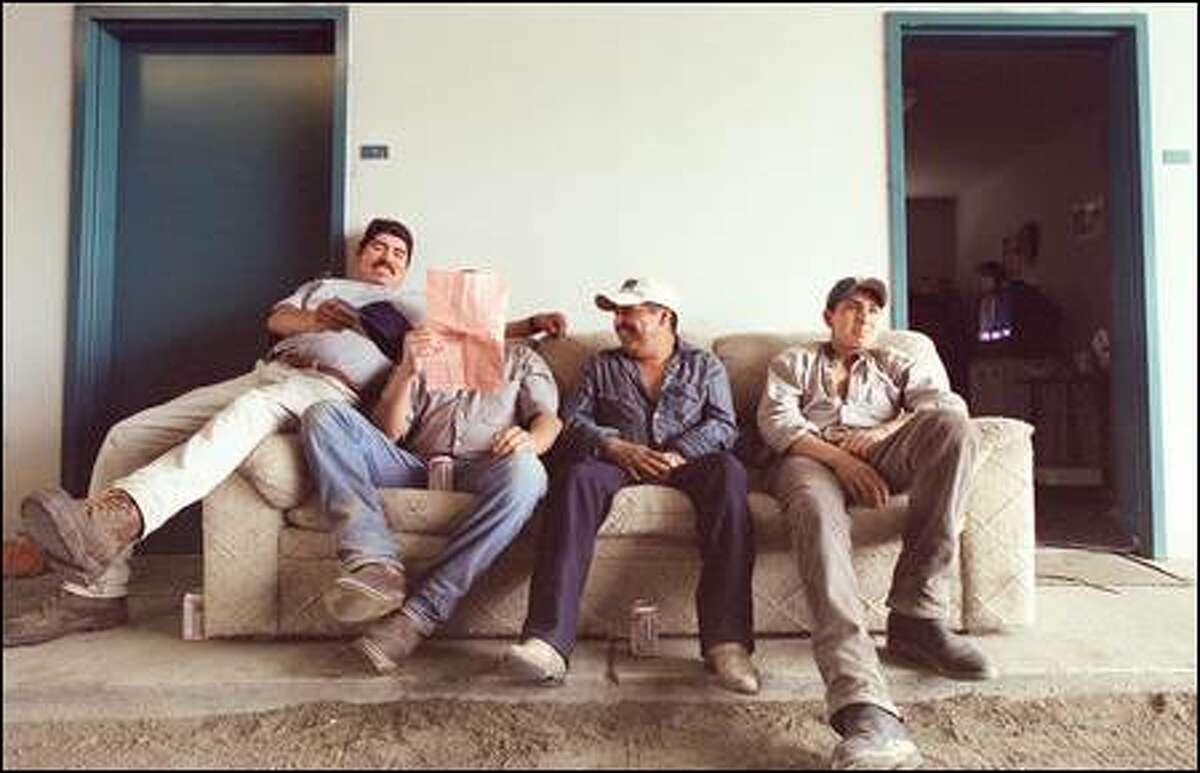 Baudelio Rios Rivera, Ramon Flores, Leobardo Camacho and Marion Rivera relax on a couch outside dorm rooms at Emerald Downs.
