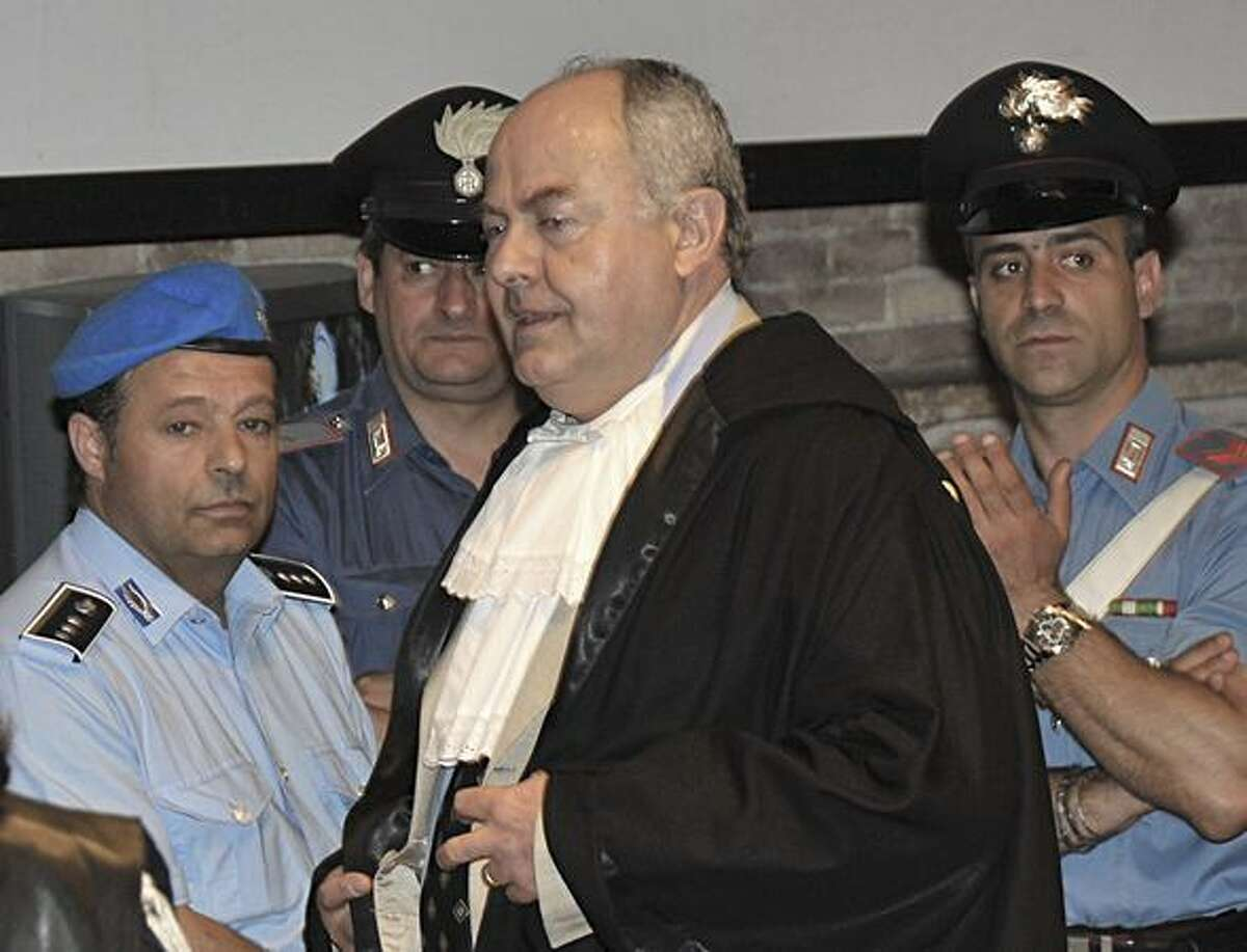 Prosecutor Giuliano Mignini arrives for a hearing in the Meredith Kercher murder trial, in Perugia, Italy, on June 13. Amanda Knox of Seattle and her former Italian boyfriend, Raffaele Sollecito, are on trial for the murder of Knox's British roommate, student Meredith Kercher, found dead in the house they shared in November 2007. (AP Photo/Stefano Medici)