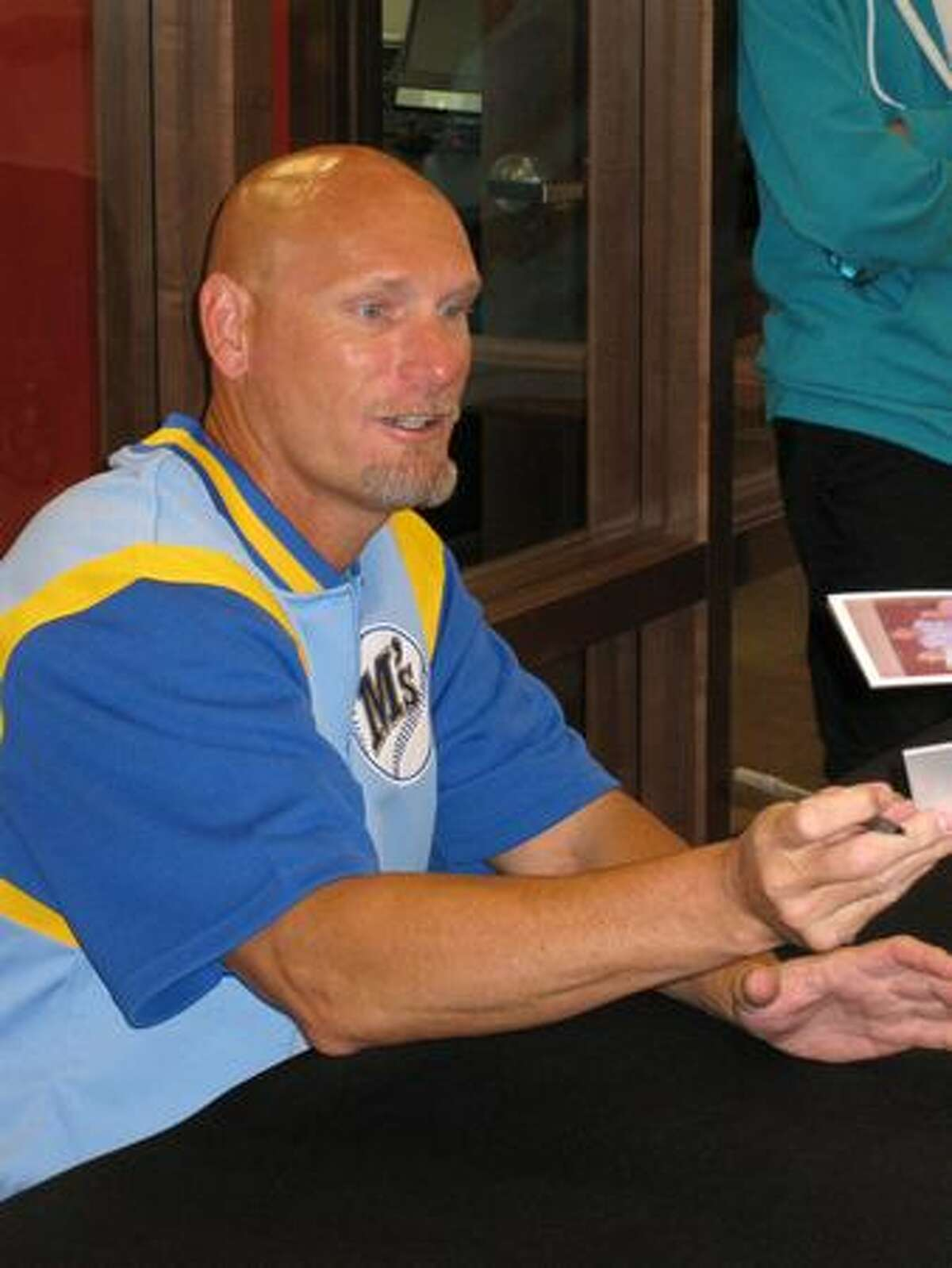 Jay Buhner signs autographs during an appearance Tuesday at a new KeyBank in Renton.