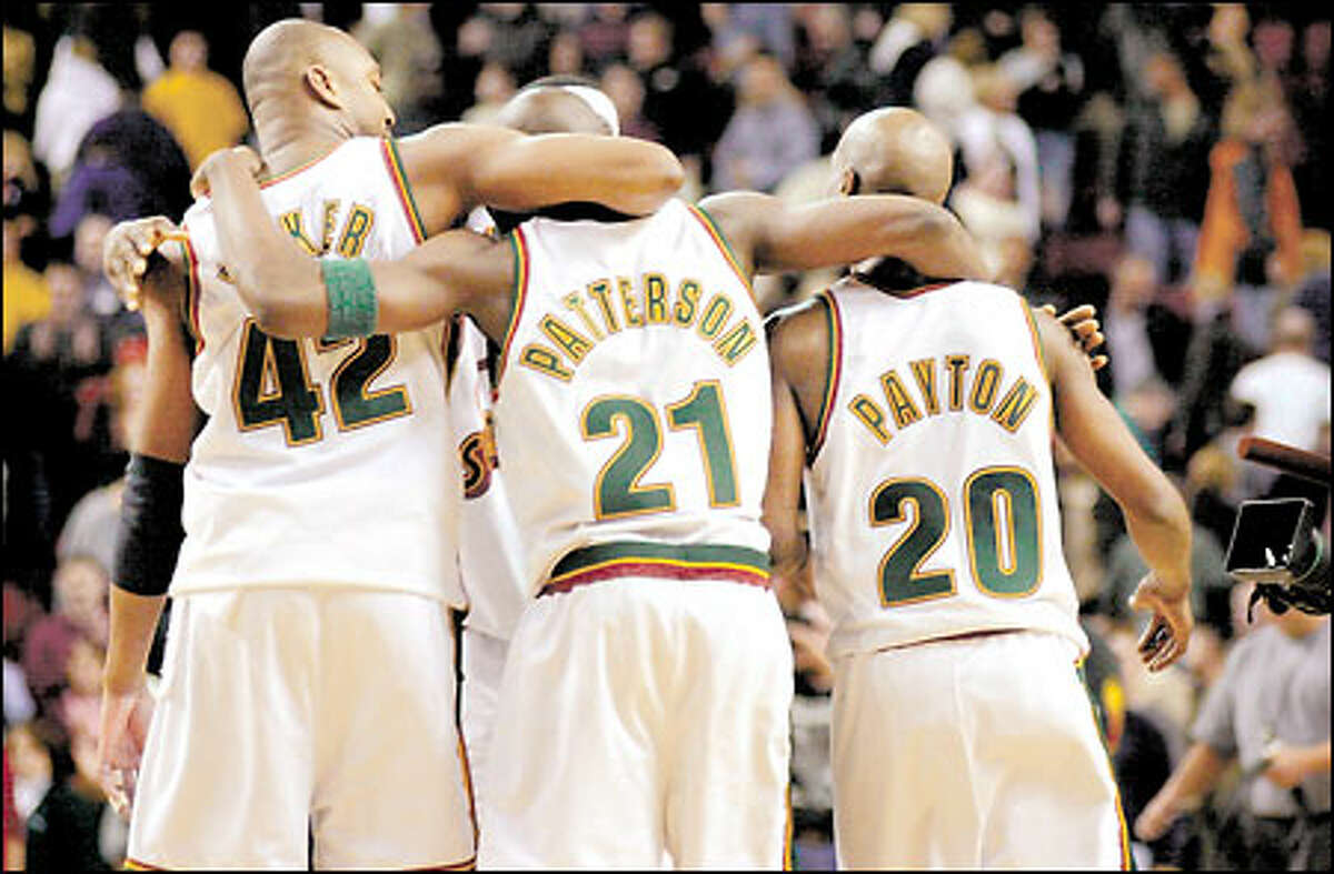Vin Baker, Ruben Patterson and Gary Payton walk off the court arm-in-arm after a victory over the Kings on Jan. 21. Chances are the three will be gone before the season starts.