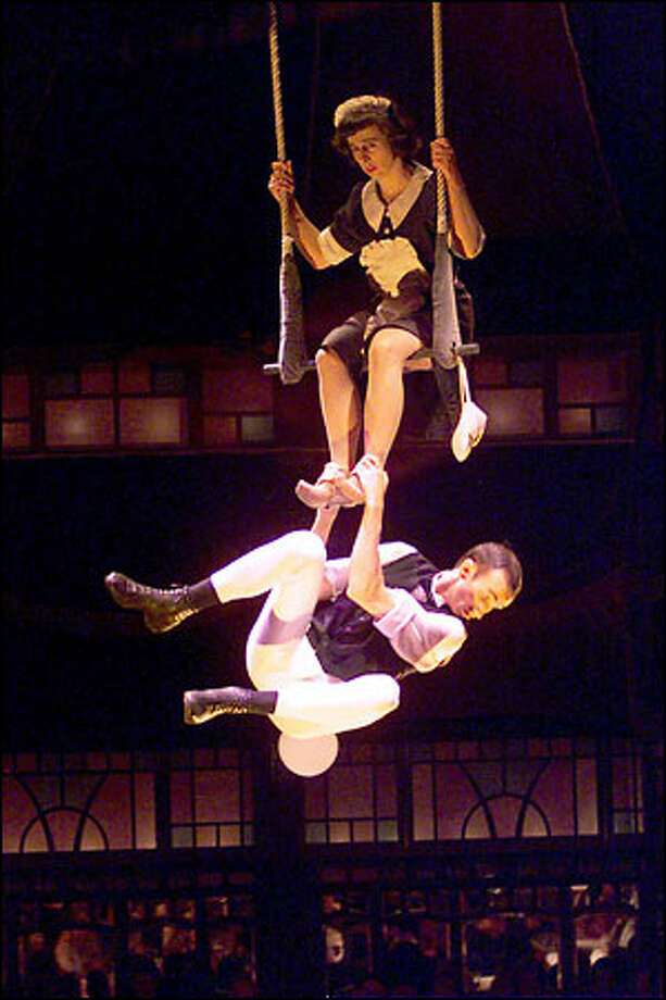 "Sabine Maier and husband Joachim ""Yogi"" Mohr go through their hilarious routine on the trapeze during the Teatro ZinZanni dinner. Photo: Mike Urban, Seattle Post-Intelligencer / Seattle Post-Intelligencer"