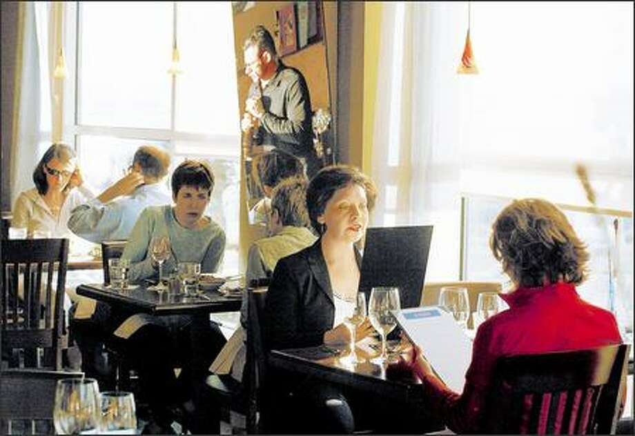 Patrons at Barocho, at the corner of Western Avenue and Broad Street, have a view of Elliott Bay. Also recommended is a perch at a high table near the bar, dining on smaller dishes. Photo: Meryl Schenker, Seattle Post-Intelligencer / Seattle Post-Intelligencer