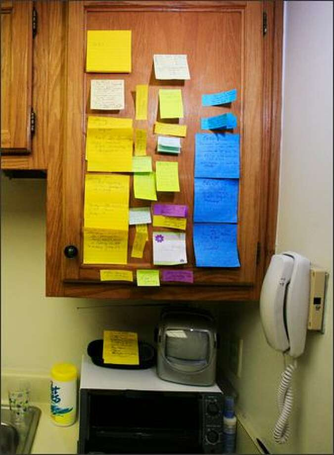 Color-coded Post-it notes organize and plan the lives of Frank Sterling Long and wife Shirley Knappe. Photo: New York Times / New York Times