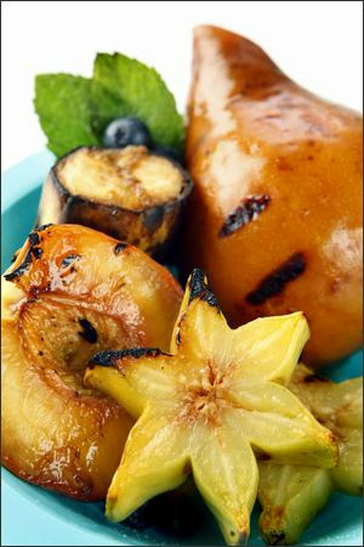 Grilled fruit is brushed with a ginger syrup.