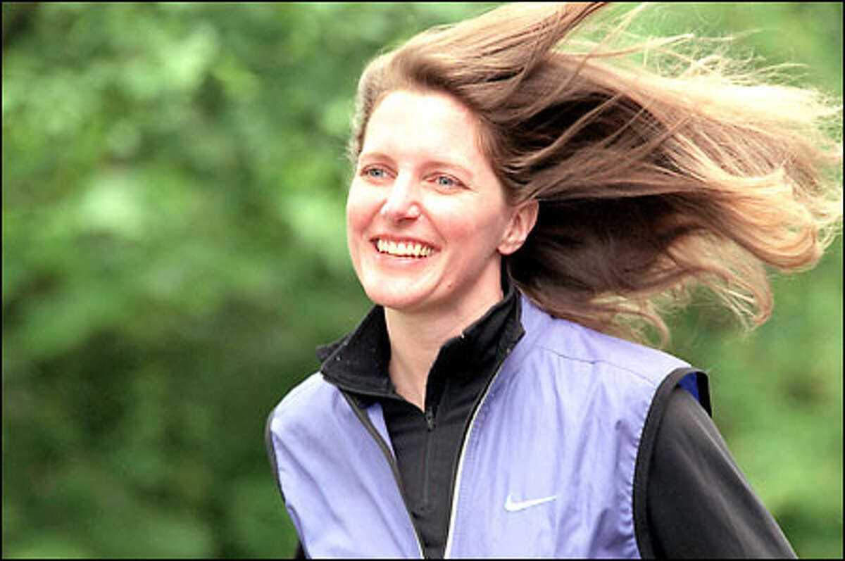 Kathleen Hebert, vice president of the Small Business division at Microsoft, goes out for a run on the Microsoft campus. She has been described as smart, energetic and driven.