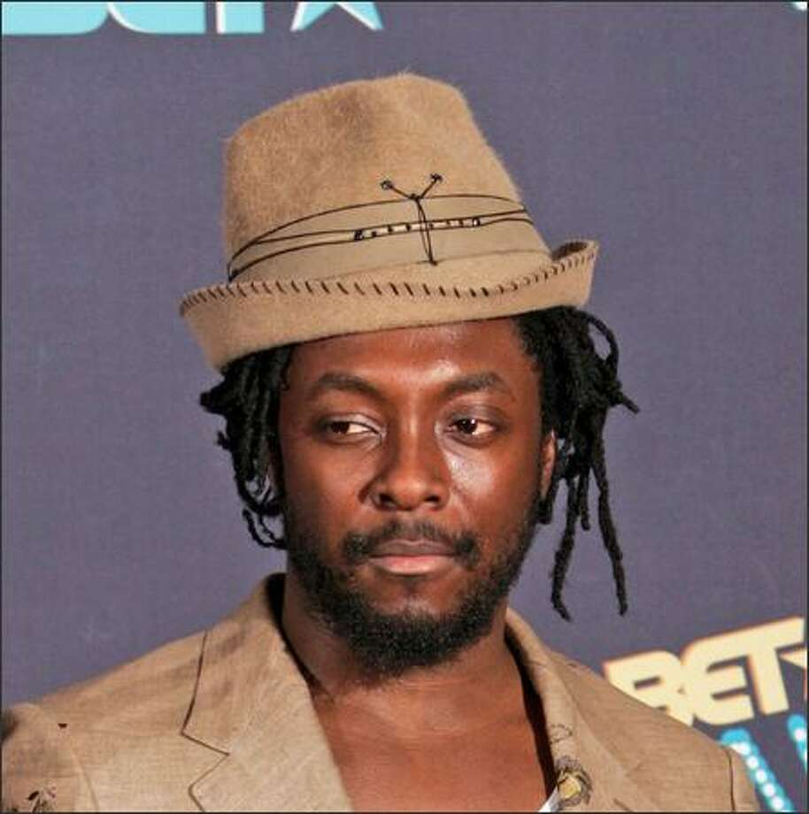 "Say it isn't so: Black Eyed Peas' charming lead singer Will.i.am (William Adams) is being investigated by Berlin police after a brawl involving ""serious bodily harm"" to a club doorman, says The Associated Press. He's shown here last week at the sixth annual BET Awards in Los Angeles. Photo: Associated Press / Associated Press"