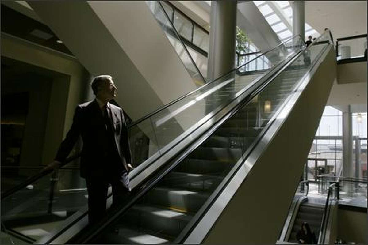 Developer Kemper Freeman rides the escalator at Lincoln Square, one of three Bellevue properties that he's upgrading and expanding over the next five years.