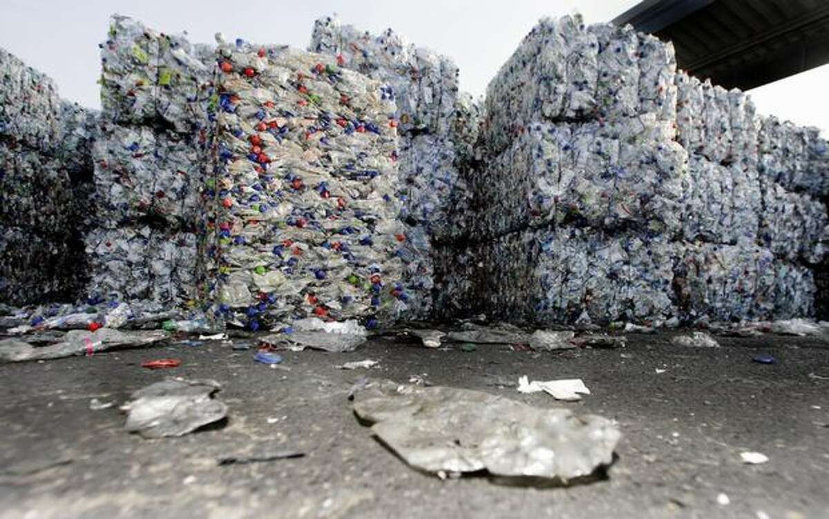 Compressed plastic bottles are piled up at a polyethylene terephthalate recycling center in Beselich, Germany, in this October 2007 file photo. The bottles are washed, crushed and transformed into plastic flakes, which then can be recast into new bottles.