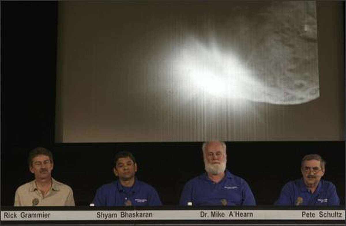 NASA scientists comment on data received after the success of the Deep Impact mission. NASA used a space probe to chase down a speeding comet 83 million miles away and slammed it into the frozen ball of dirty ice and debris in a mission to learn how the solar system was formed. (AP Photo/Damian Dovarganes)