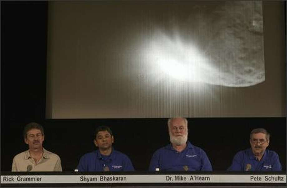 NASA scientists comment on data received after the success of the Deep Impact mission. NASA used a space probe to chase down a speeding comet 83 million miles away and slammed it into the frozen ball of dirty ice and debris in a mission to learn how the solar system was formed. (AP Photo/Damian Dovarganes) Photo: Associated Press / Associated Press