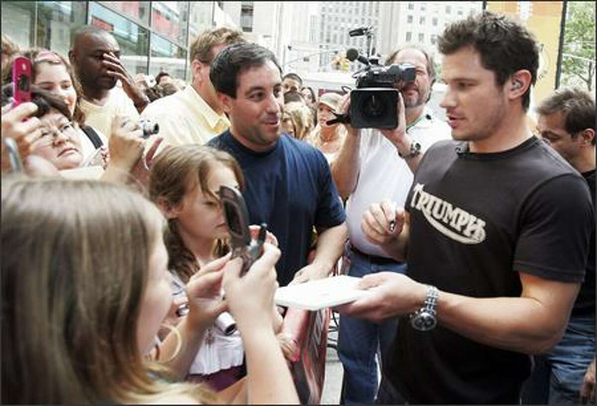 His brother Drew can dance, but what exactly does Nick Lachey do? He's a non-singer singer who's famous for being famous, thanks to his marriage/breakup with Jessica Simpson, also famous for being famous. He signed autographs during his appearance on the NBC