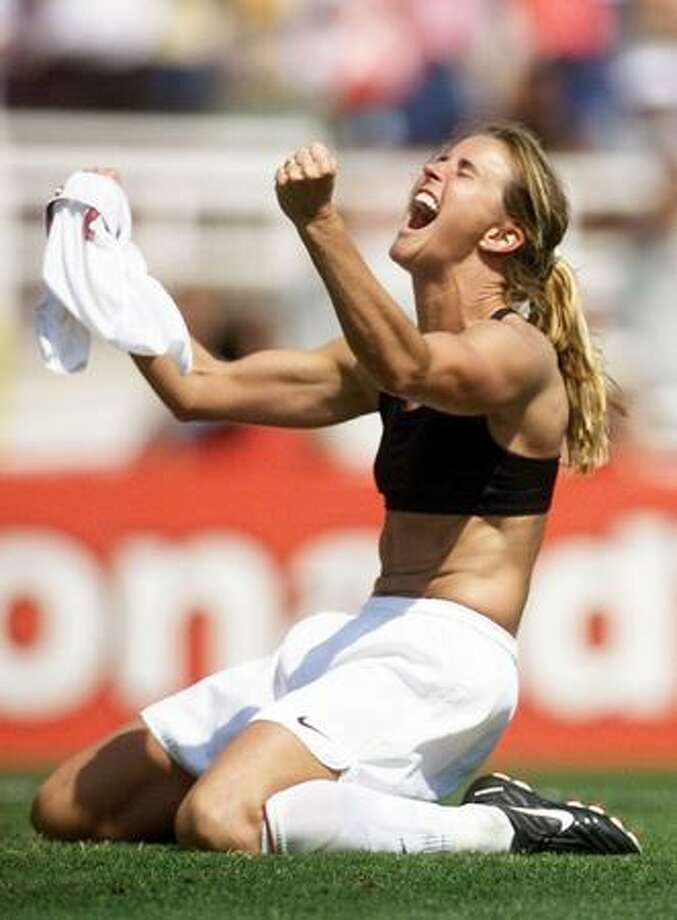 In this July 10, 1999 file photo, Brandi Chastain of the United States celebrates after kicking the winning penalty shot to win the 1999 Women's World Cup final against China at the Rose Bowl in Pasadena, Calif. Photo: Getty Images / Getty Images