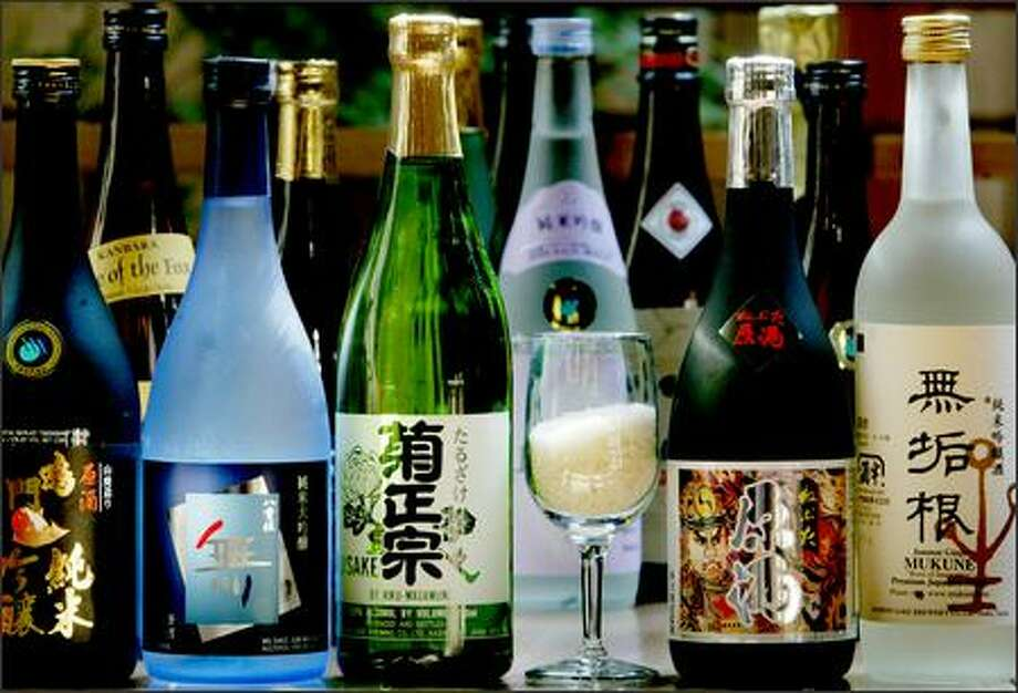 At the new Umi Sake House in Belltown, there are dozens of sakes available, ranging from $25 to $140 per bottle. Photo: Dan DeLong, Seattle Post-Intelligencer / Seattle Post-Intelligencer
