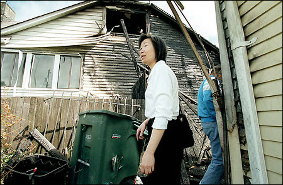 Su Jin has lived in this house at 3022 18th Ave. S. on Beacon Hill for 11 years. A fire Wednesday night caused about $200,000 in damage and badly damaged the house next door, too. Jin was unhurt. Photo: Paul Joseph Brown, Seattle Post-Intelligencer / Seattle Post-Intelligencer