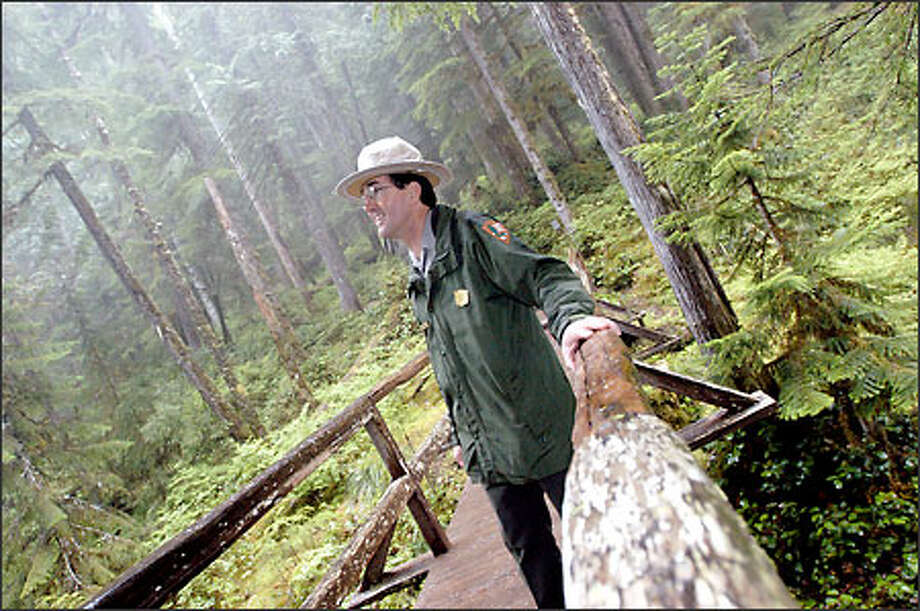 Dave Uberuaga, superintendent of Mount Rainier National Park, walks on a bridge in need of renovation at the park. Mount Rainier National Park is the nation's fifth-oldest national park, hosting about 2 million visitors a year. Uberuaga is worried about keeping it in shape for the guests. Photo: Associated Press / Associated Press