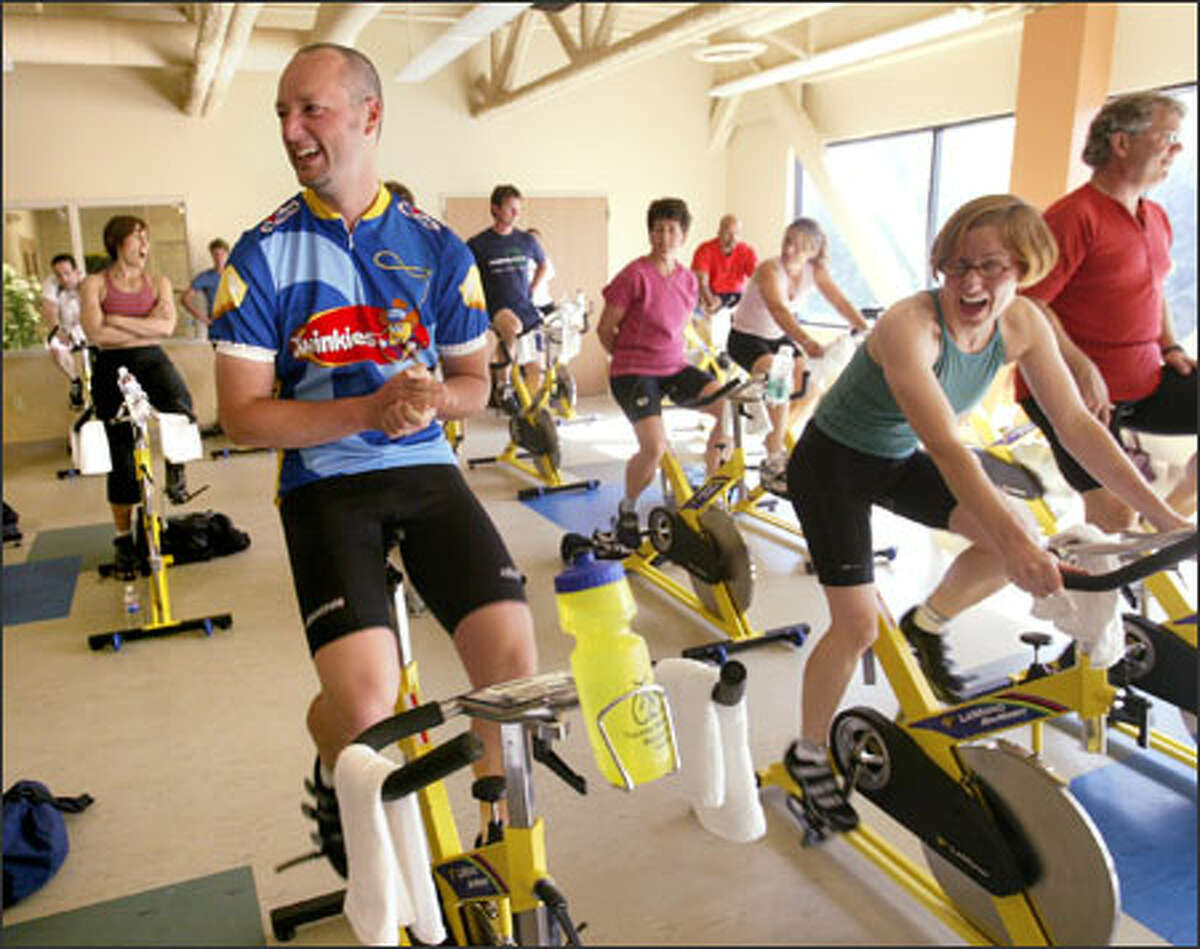 A year after taking up cycling, Nick Moody and Christine Lindquist have lost a combined 100 pounds and will pedal in the 206-mile Seattle to Portland Bicycle Classic Saturday. Here, they take a break during their cycling class, part of an intense regimen, at West Seattle's All Star Fitness.
