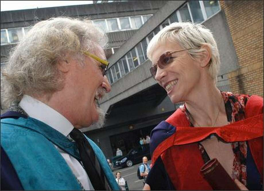 "Annie Lennox said she felt like a ""complete fraud"" accepting an honorary degree from the Royal Scottish Academy of Music and Drama in Glasgow, Scotland, on Tuesday. She's with fellow college dropout Billy Connolly, who wasn't embarrassed to accept his award. Feeling non-worthy tends to be a girl thing. Photo: Associated Press / Associated Press"