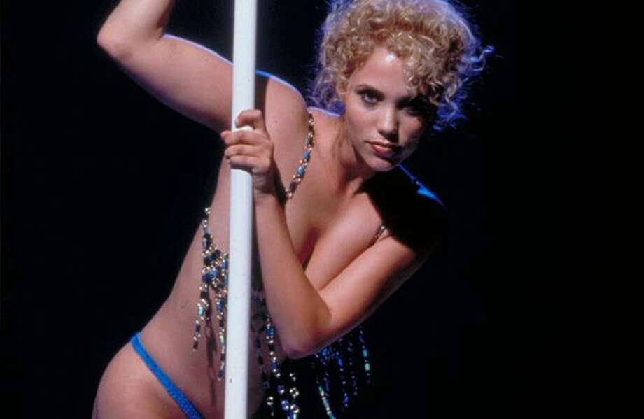 "Actress Elizabeth Berkley as Nomi Malone in ""Showgirls"" (1995), a film as noteworthy for its copious and gratuitous nudity as for its cheesy acting and dubious plot."