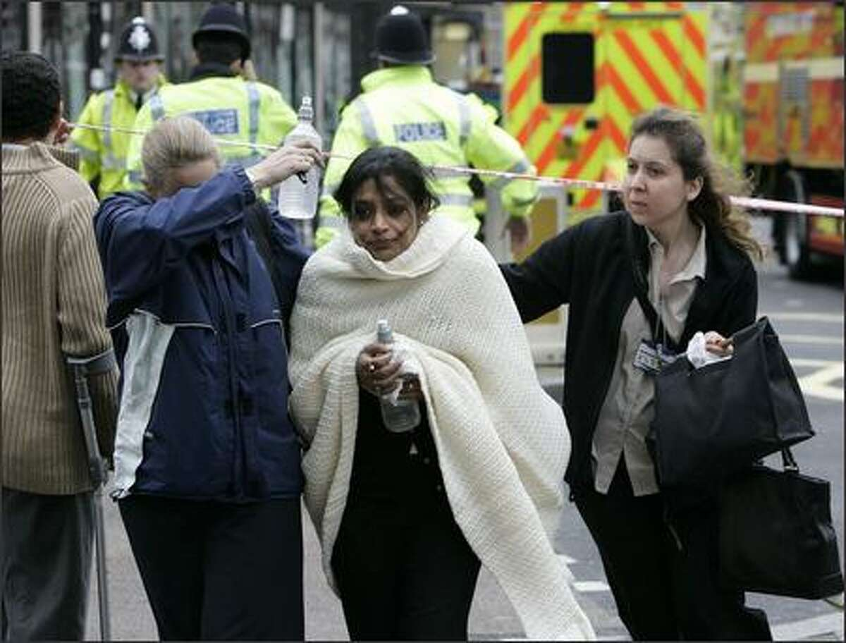 Walking wounded leave Edgware Road tube station in London. (AP Photo/Edmond Terakopian/PA)